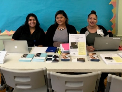 PCC West Town Family Health Center staff at welcome table